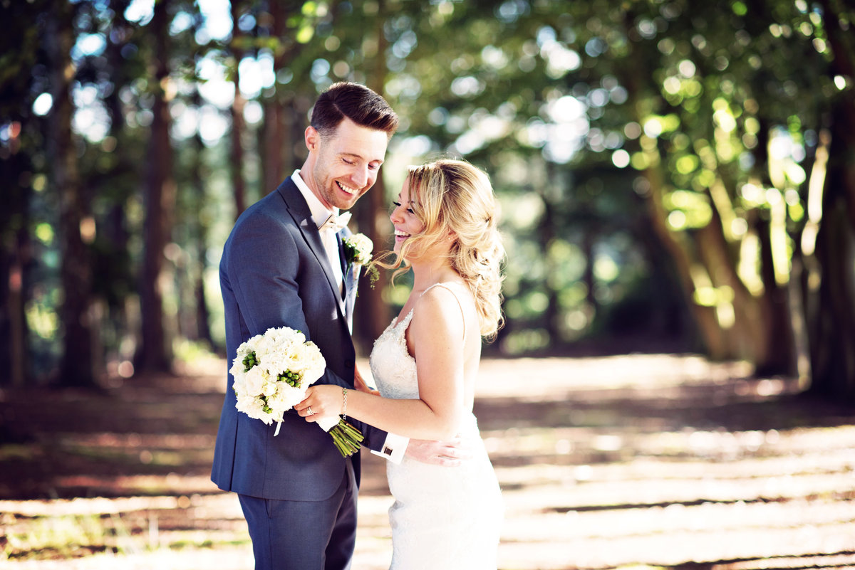 A Bride and Groom in the woods at Nunsmere Hall