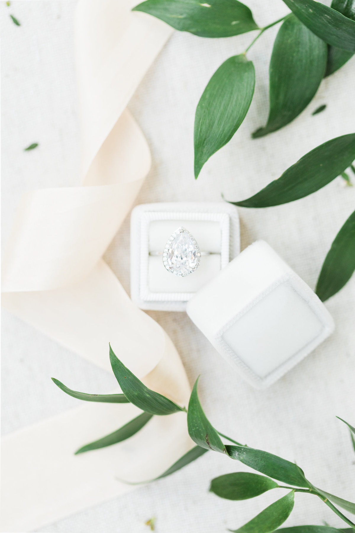 tear drop wedding engagement ring inspiration with greenery