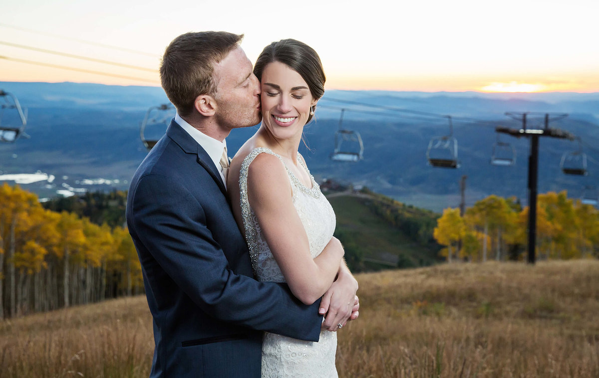 Gorgeous-Wedding-on-top-of-a-mountain-in-Steamboat-Springs-at-Four-Points-Lodge-with-Ski-Lift-Backdrop