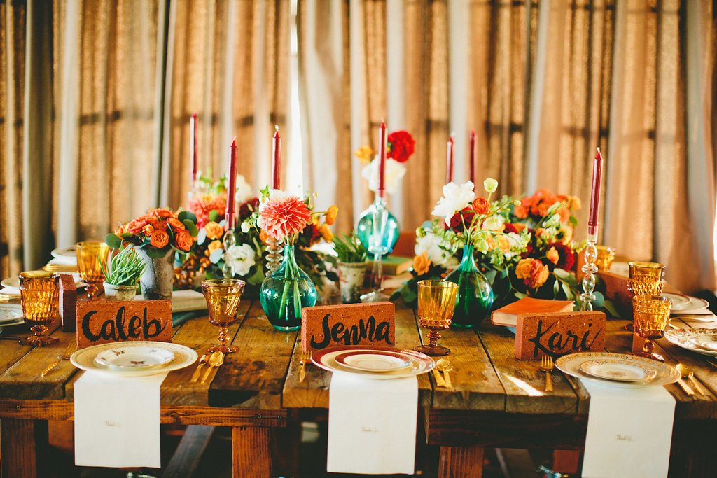 dinner party table setting with fall inspired florals and hand crafted name cards