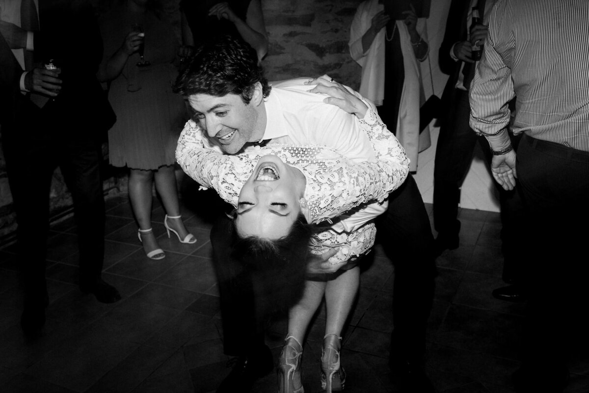 Man dipping woman on dance floor black and white