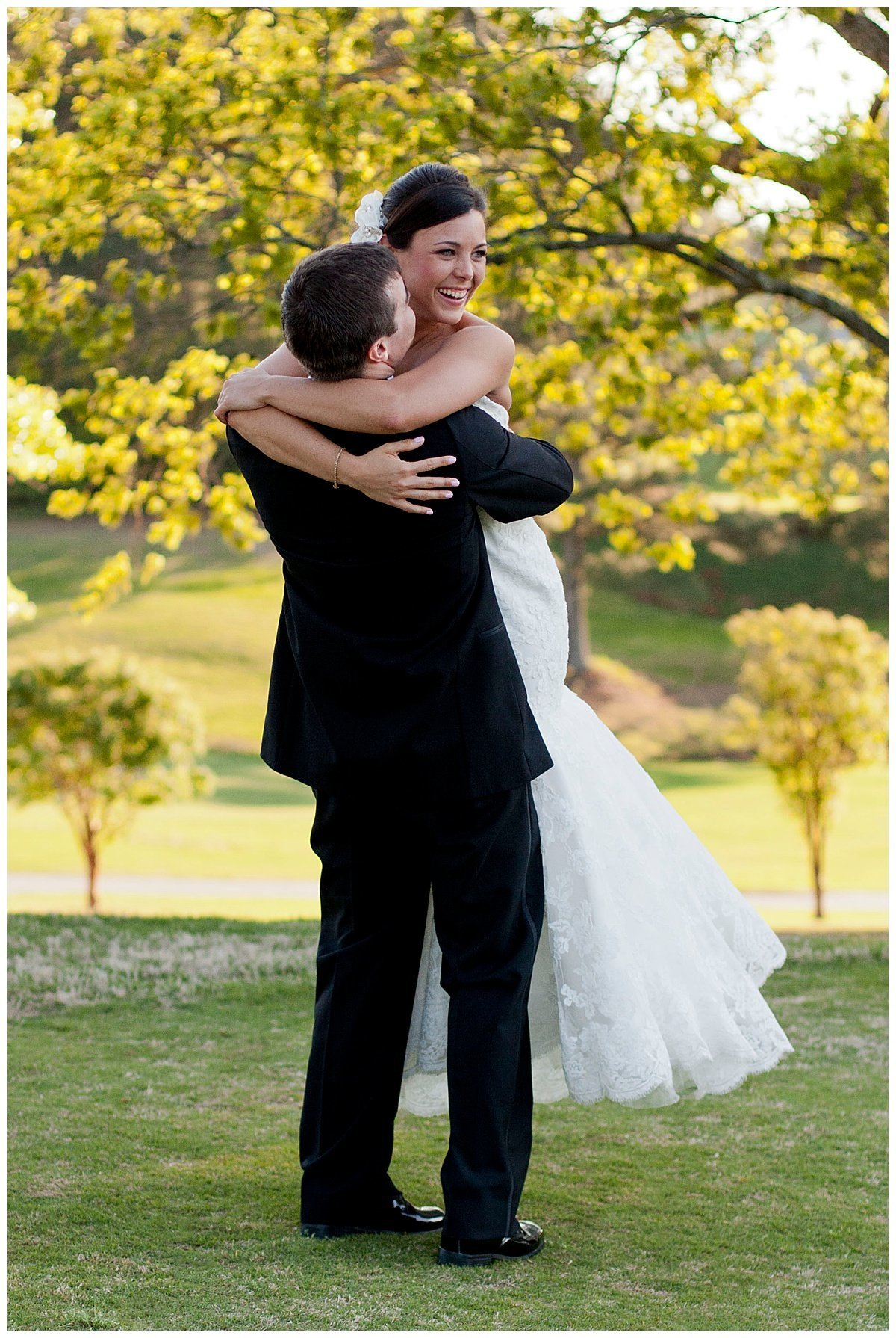 Groom spinning bride around at Summit Chase Country Club's golf course