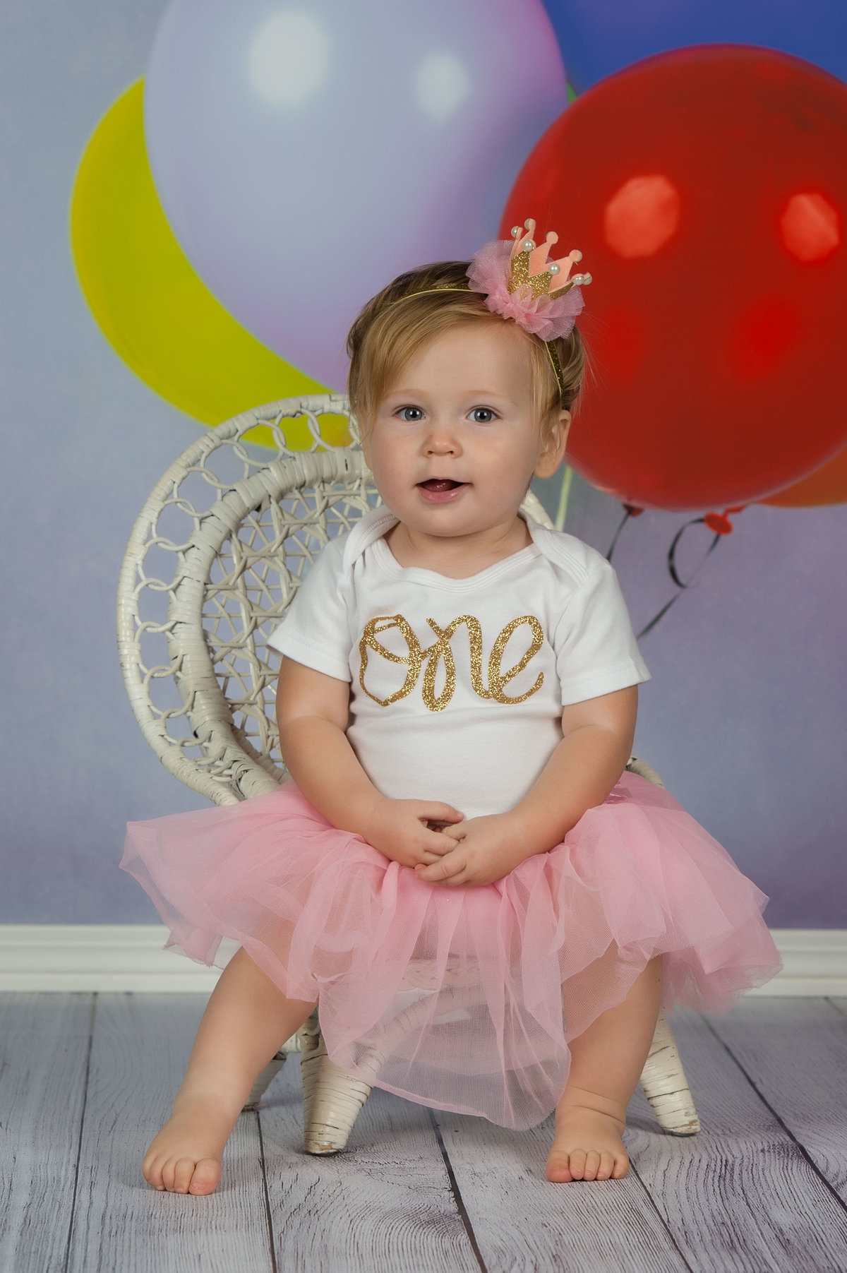 baby in studio on balloon backdrop