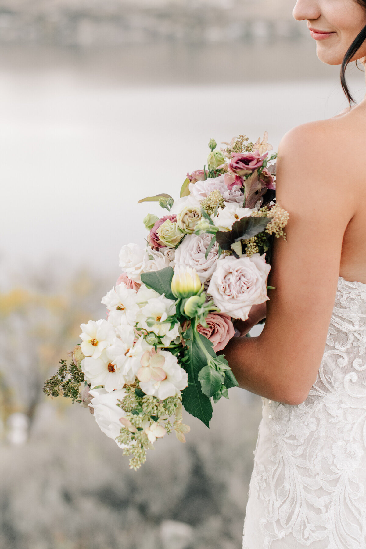 Bride holding romantic bouquet by Chelan Floral at The Lookout