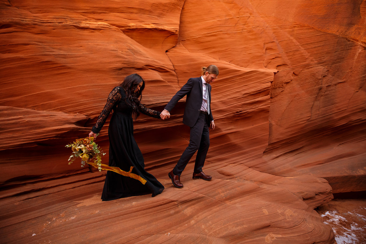 Black wedding dress inspiration from this couple who eloped in a slot canyon.