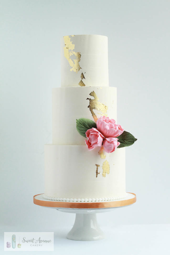 white wedding cake with gold leaf and pink peonies, wedding cakes Hamilton ON
