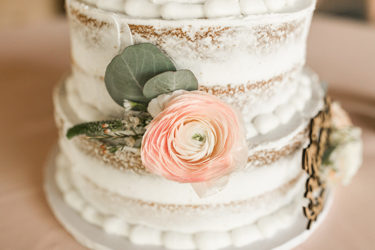 close up of rose on a cake at a savannah wedding