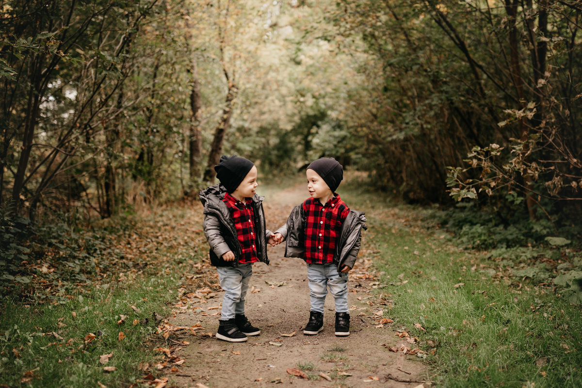 Twin boys holding hands