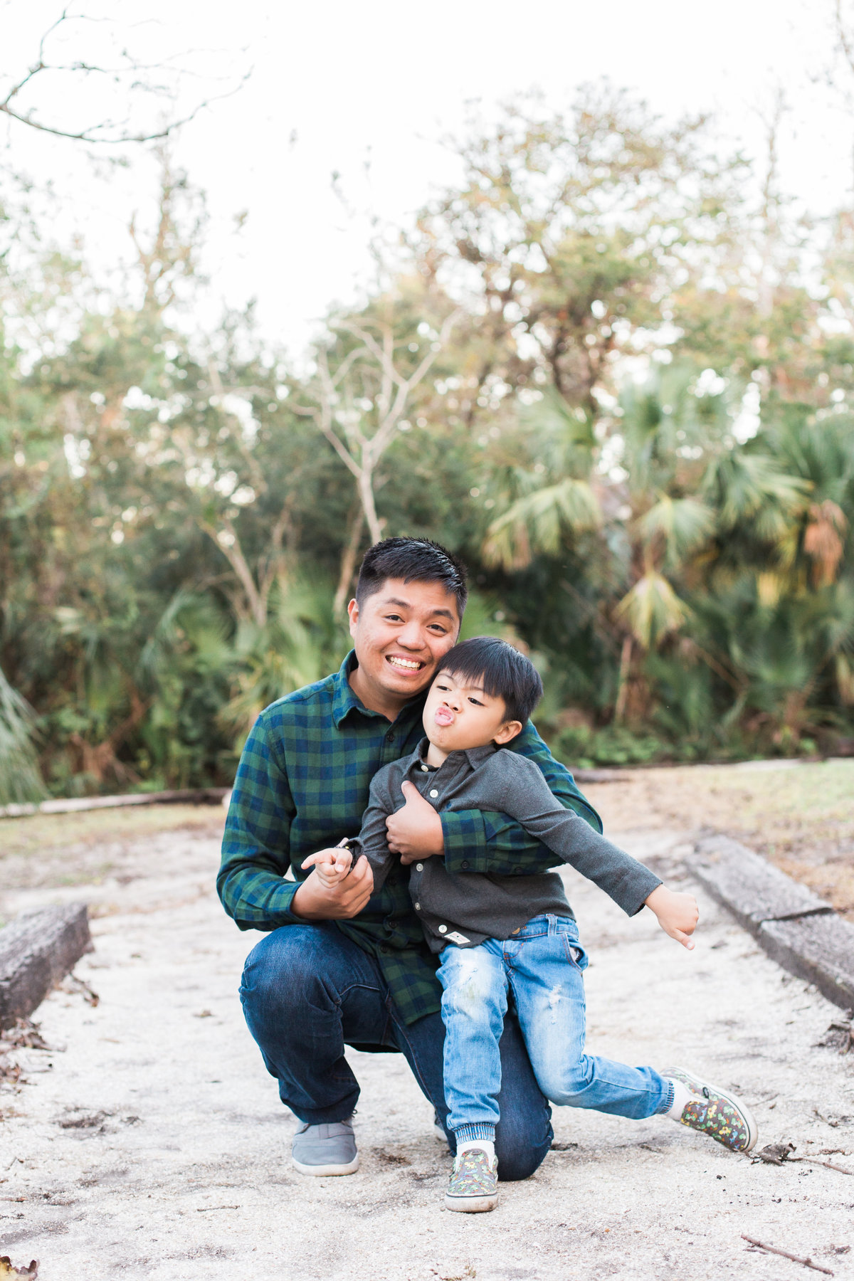 Jacksonville Family Photographer photo of a father and son smiling silly at Howell Park in Atlantic Beach Florida