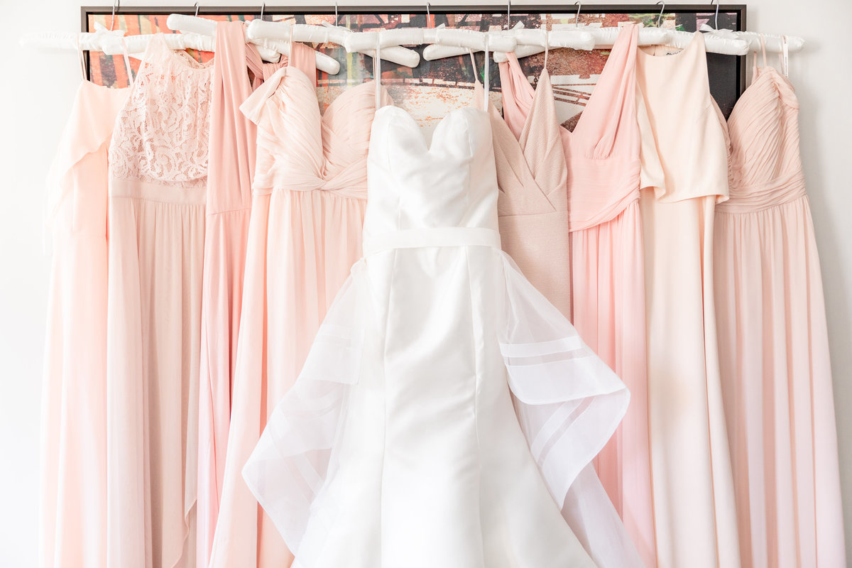 Getting ready photo idea for wedding with light pink bridesmaid gowns and wedding dress at NJ wedding