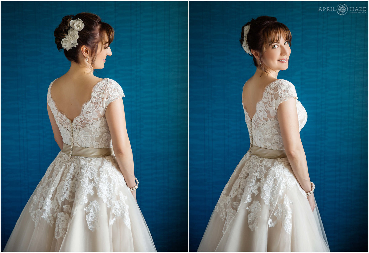 Bride poses for a portrait in front of the gorgeous blue wall in her hotel room in Cherry Creek Denver Colorado