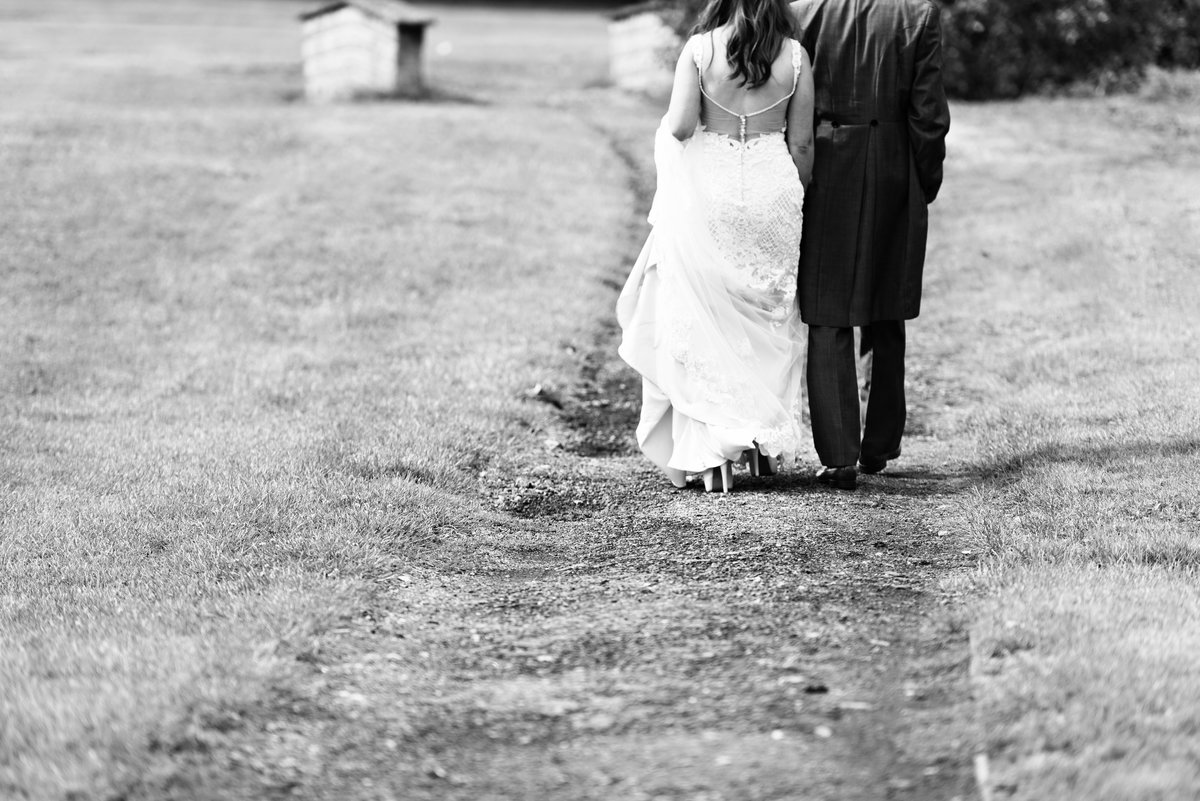 Walking away the bride and groom at Pryors Hayes
