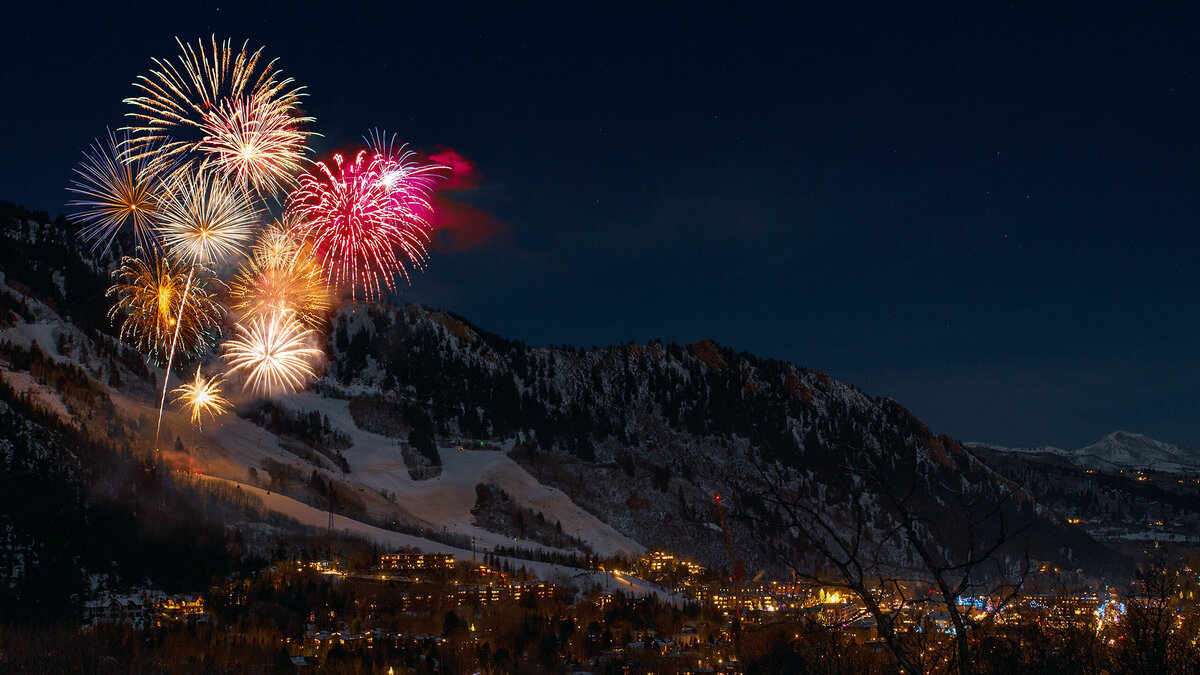 A fireworks display over a ski resort in France at a luxury party celebration.