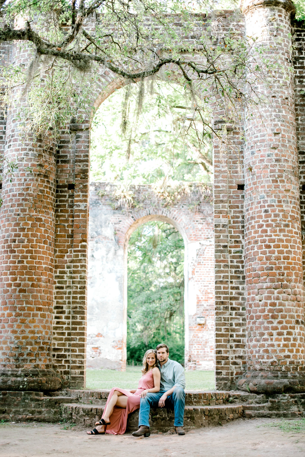 Couple sitting on church ruins
