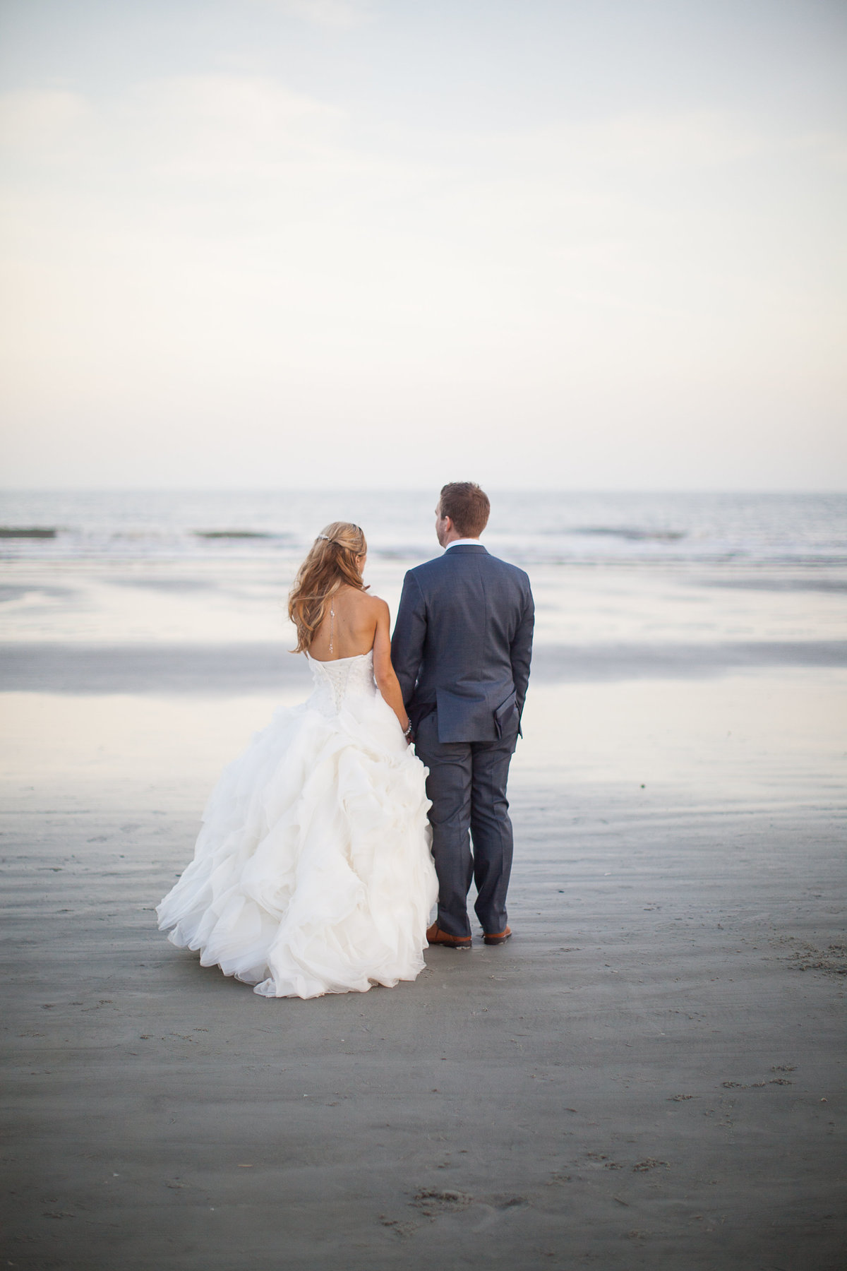 A bride and groom at their beach wedding