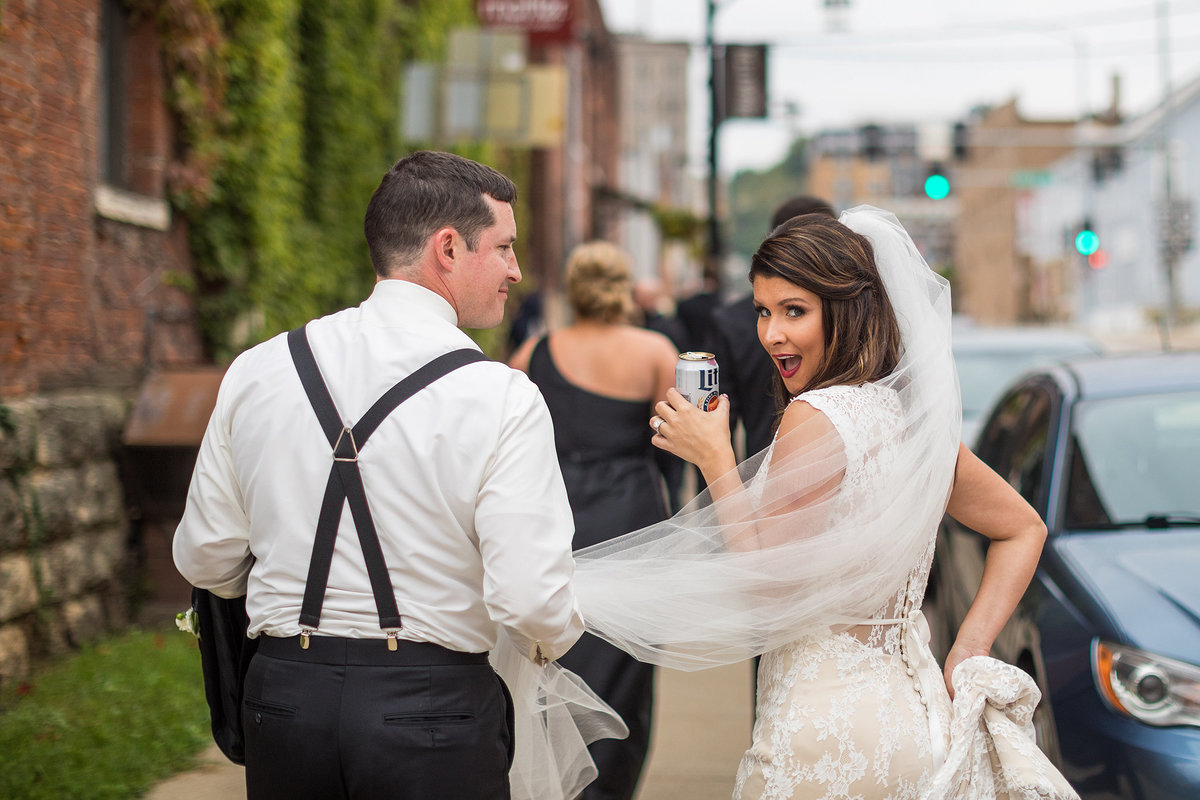 bride drinking miller lite with lipstick on beer can