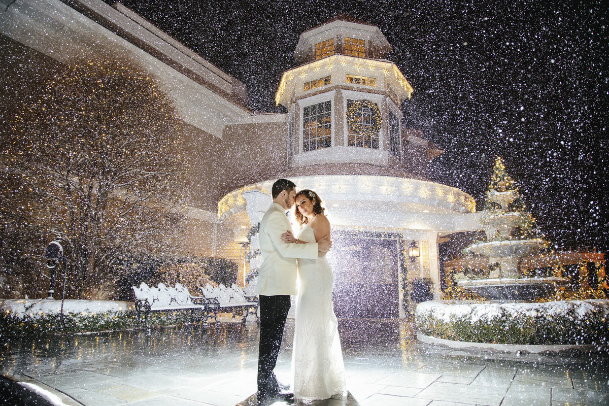 bride and groom in snow  at clarks landing yacht club