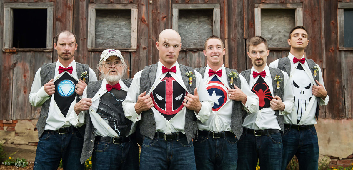 Fun groomsmen photo with secret superhero shirts on a Nebraska Farm