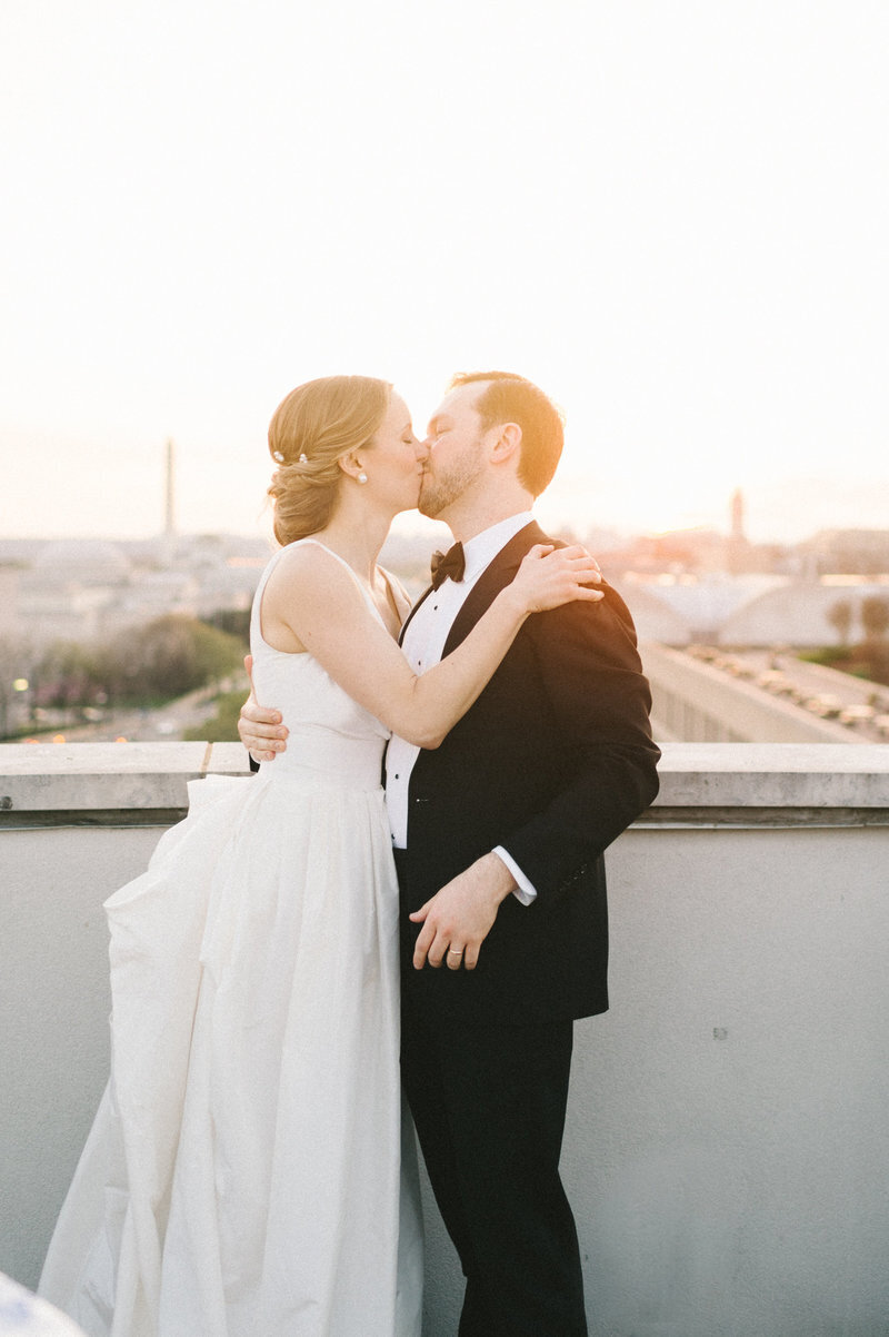sunset-bride-groom-kissing-dc-rooftop-101-constitution