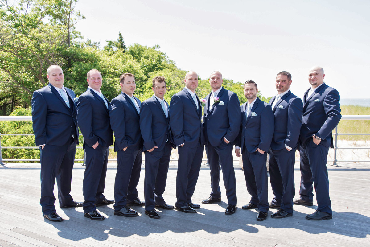 photo of groomsmen on the boardwalk from wedding at Pavilion at Sunken Meadow