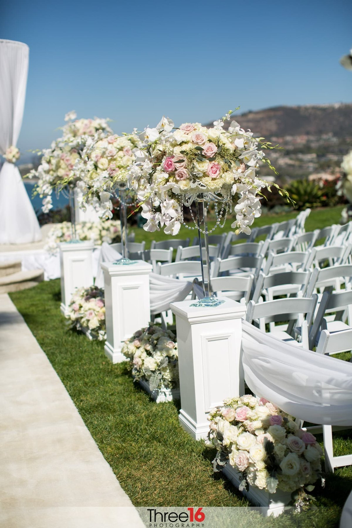 Floral arraignments amongst the wedding ceremony seating