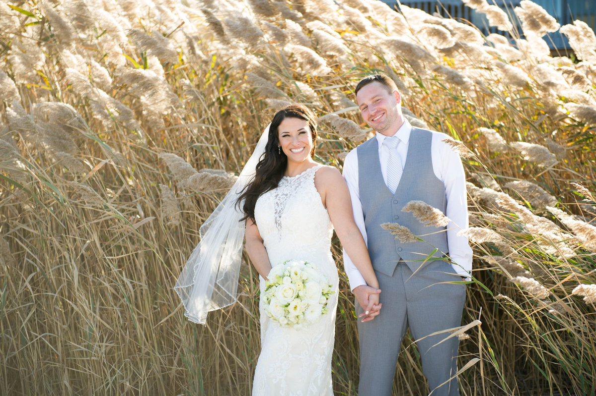 textured grasses with bride and groom