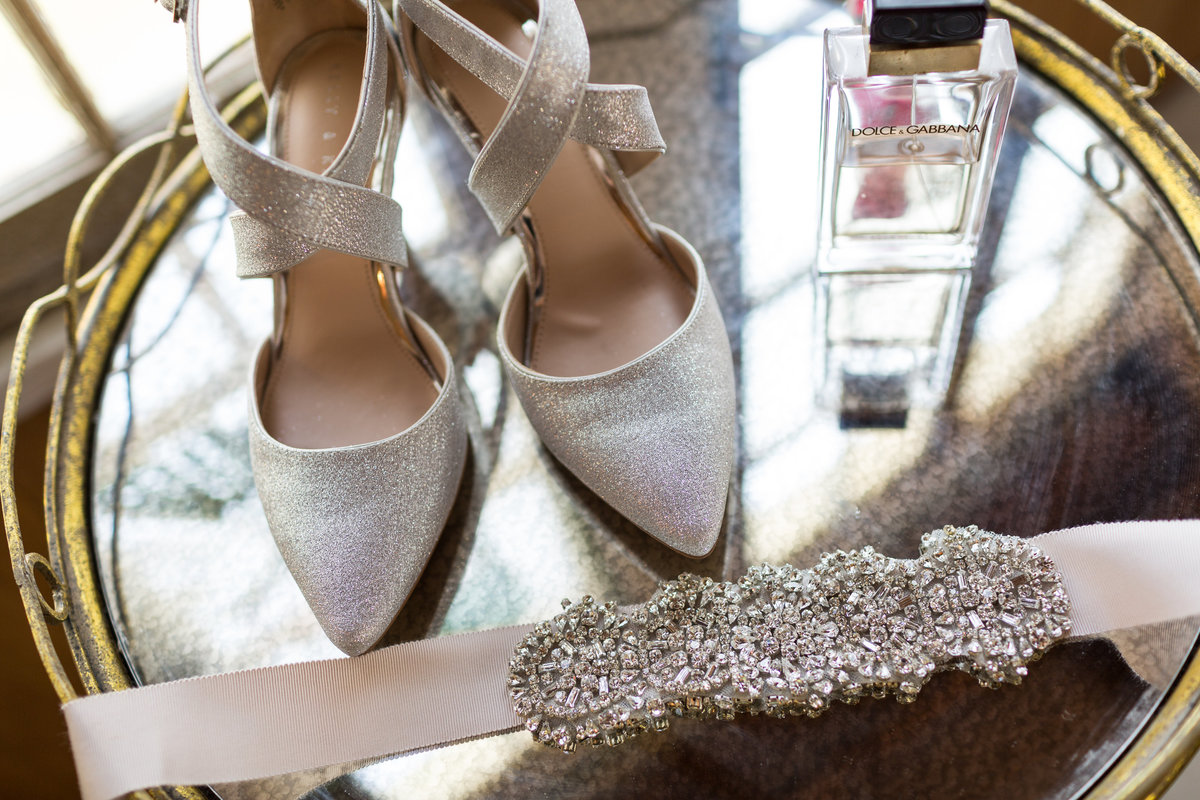 Wedding details brides shoes and waistband