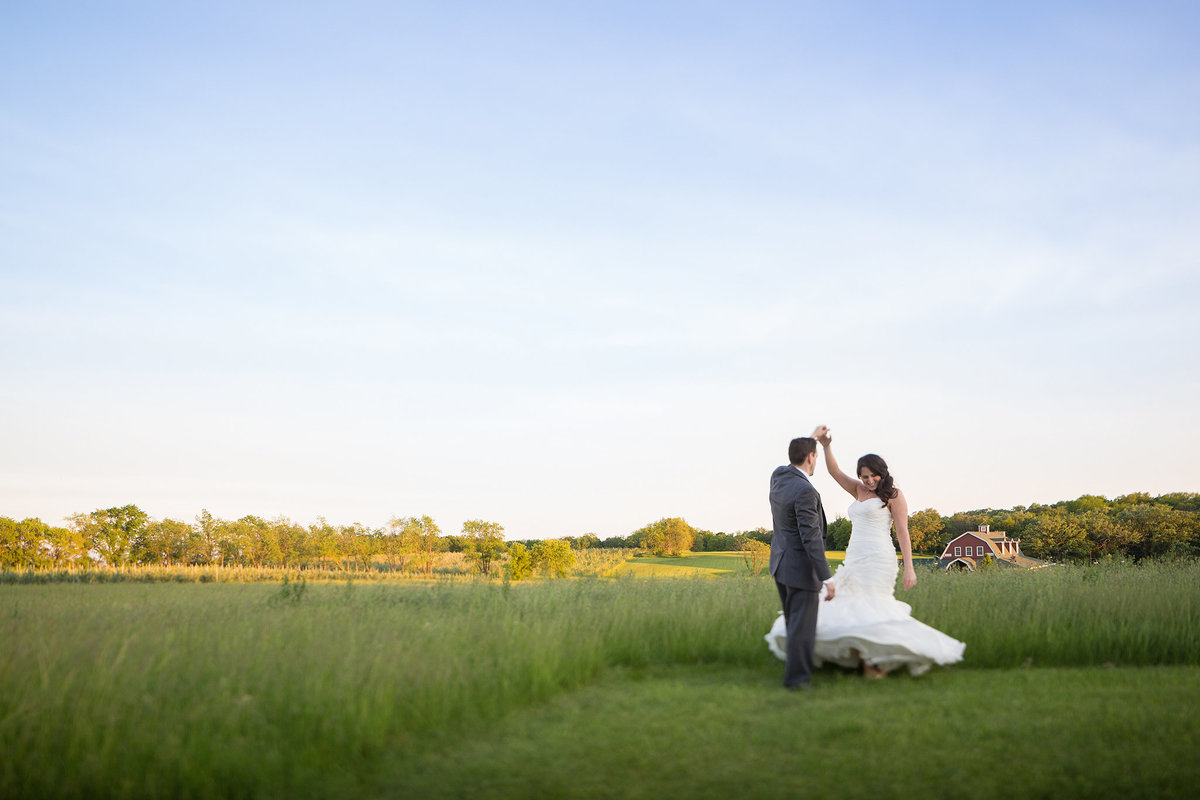 Wedding couple dancing in field at the pavilion in rockton illinois