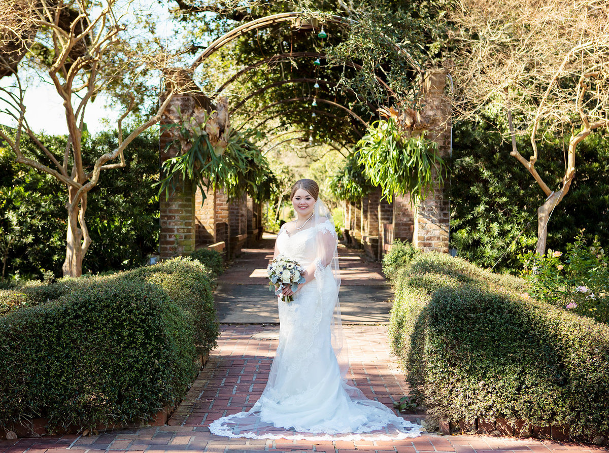 bride on the courtyard pathway in the Botanical Gardens of City Park