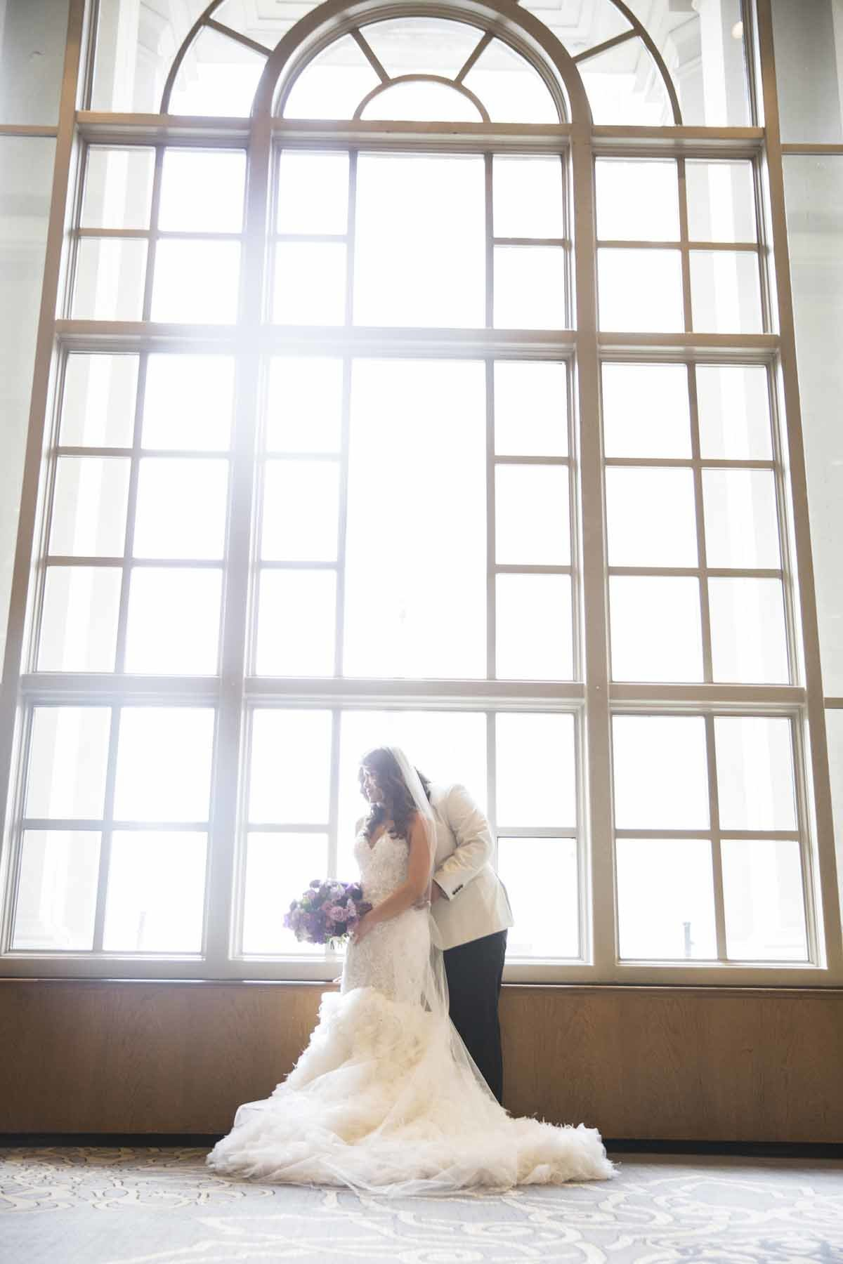 Our bride and groom posing in the sunlight.