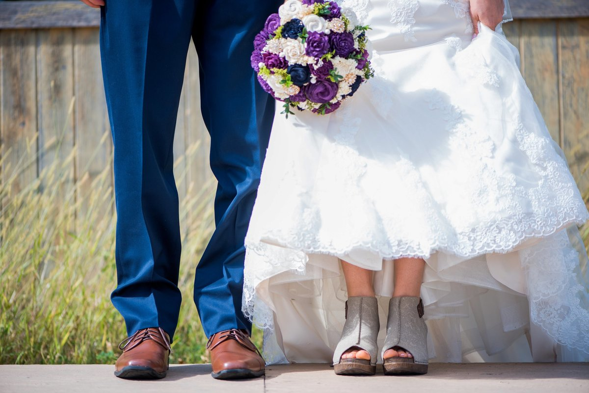Bluestem wedding even center detail photos of the couples shoes. Kris Kandel fargo photographer