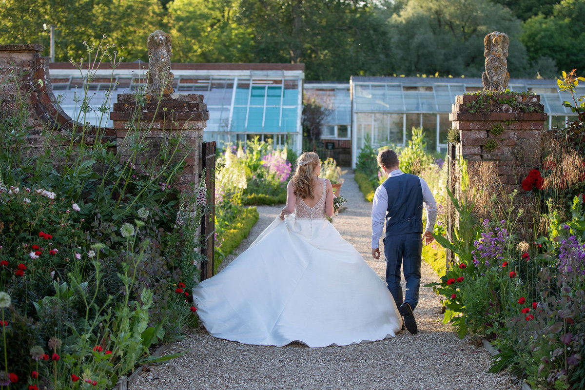 Bride and groom in the veg garden at Forde House Wedding in Somerset_