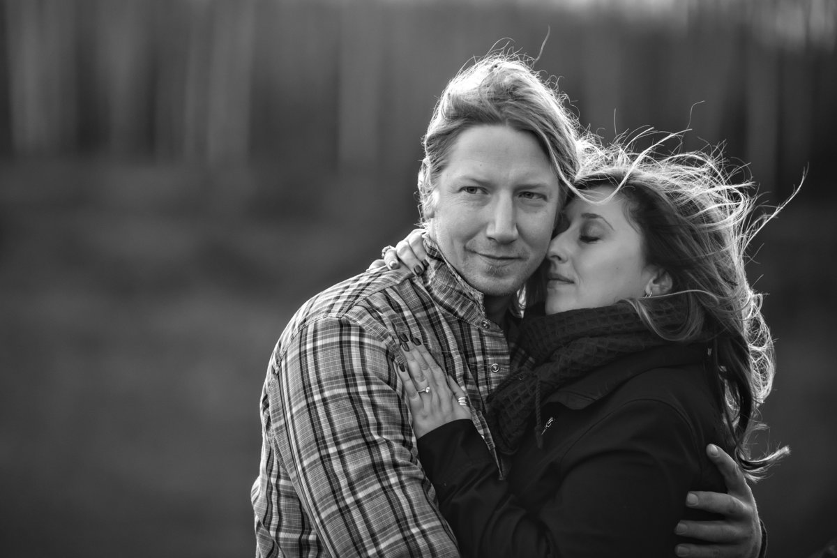 Black and white photo of couple holding each other