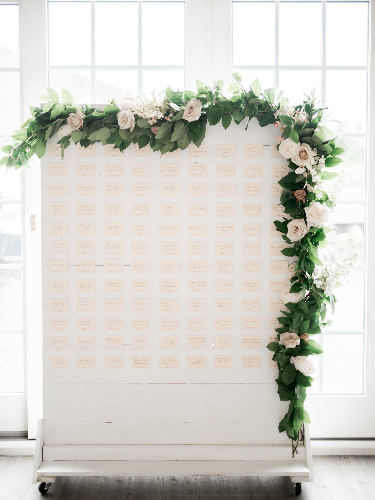 Unique escort card display and seating chart wall