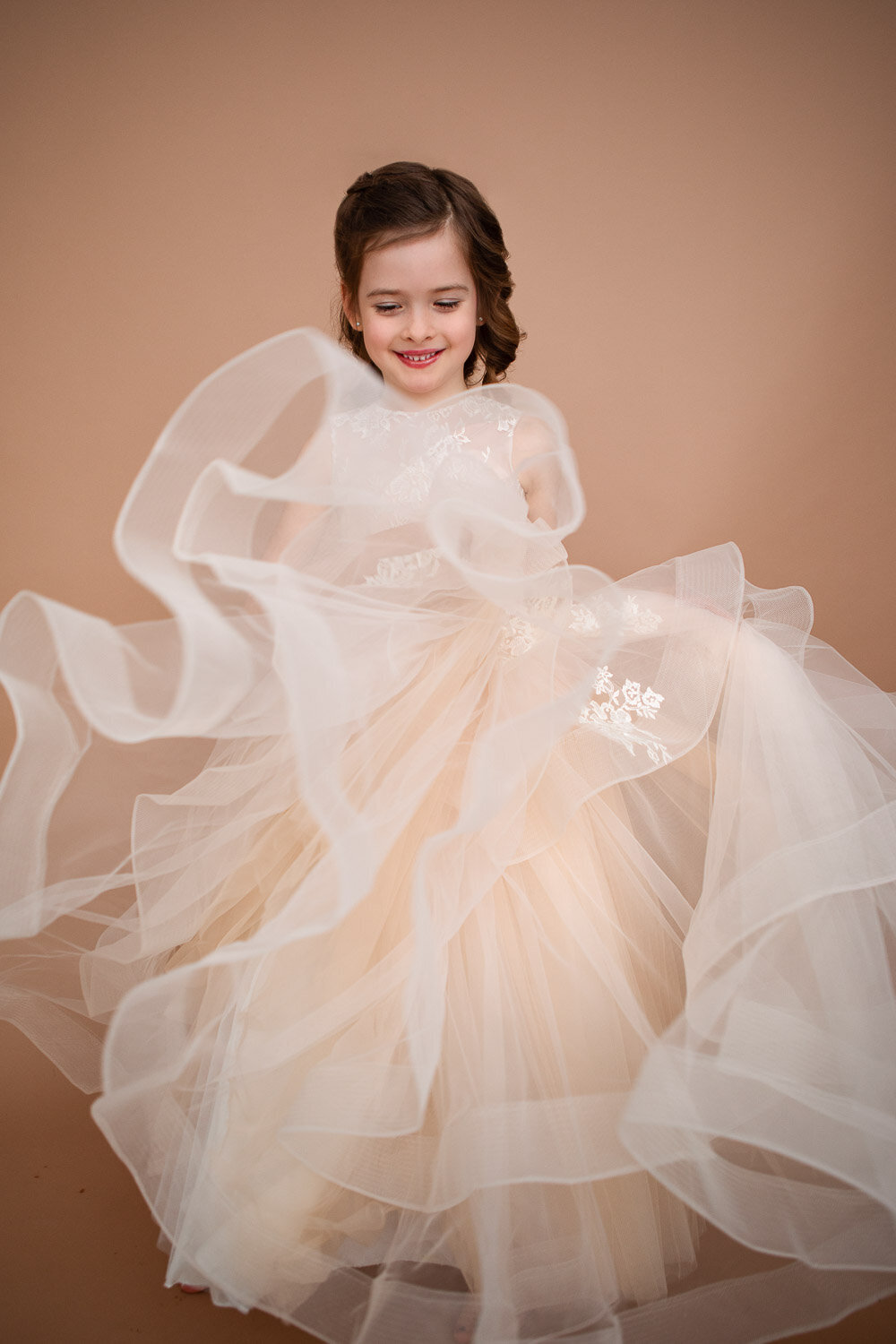 Little girl spinning in a long dress