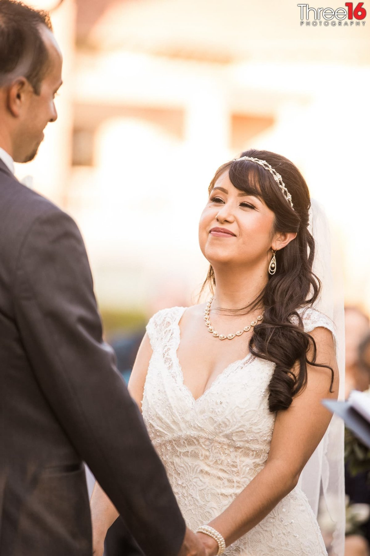 Bride looking at her Groom while taking their vows