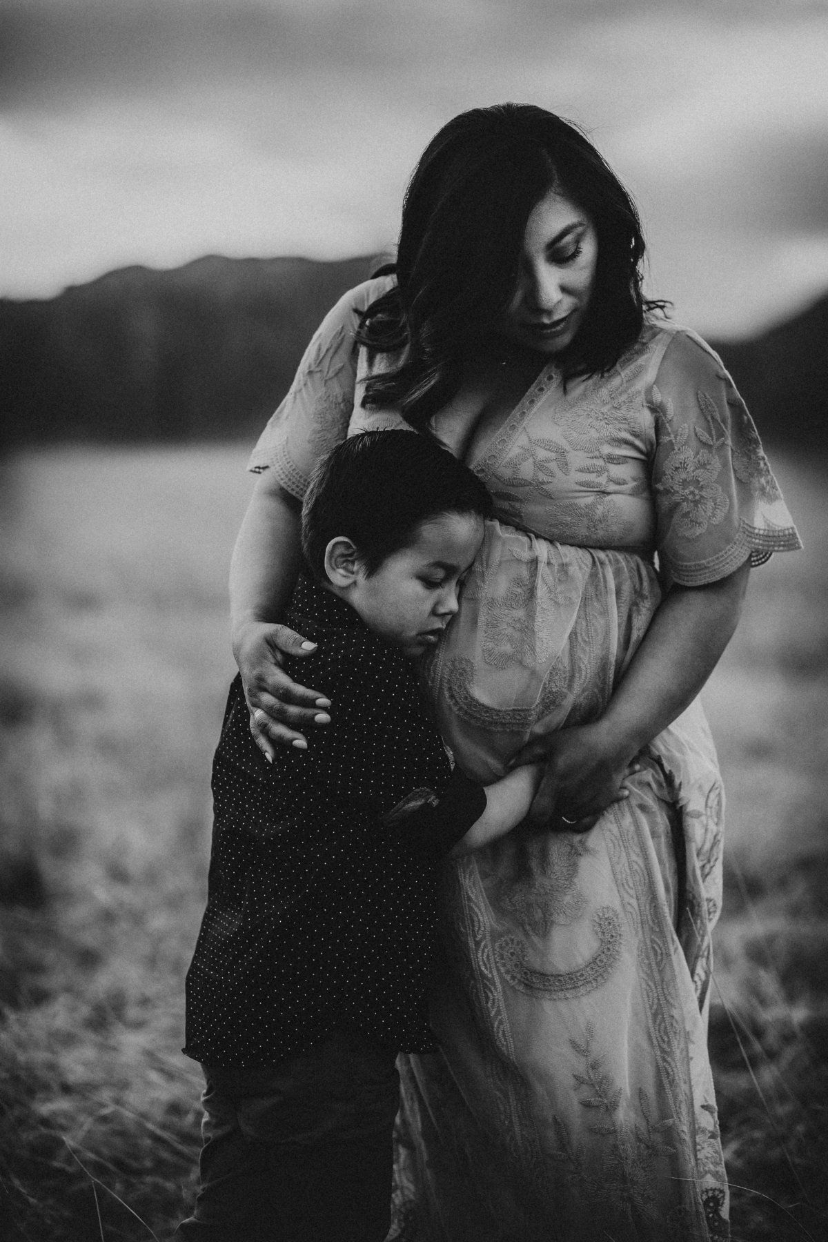 Outdoor family maternity pictures in Louisville Colorado at sunset