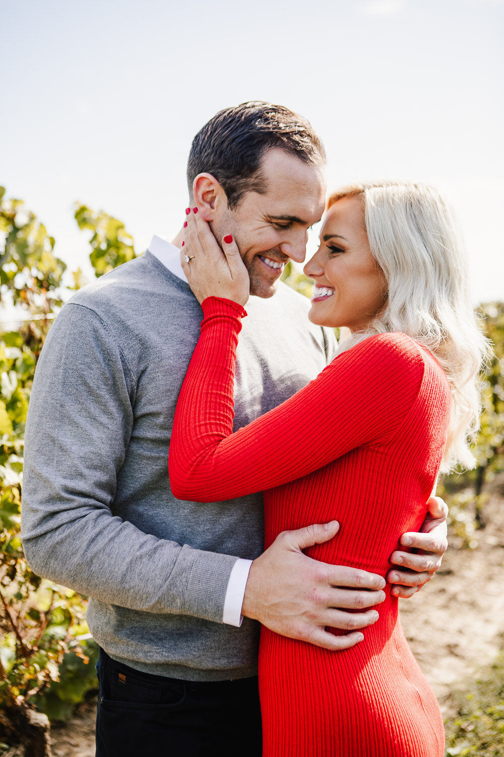 Couple embracing in vineyard