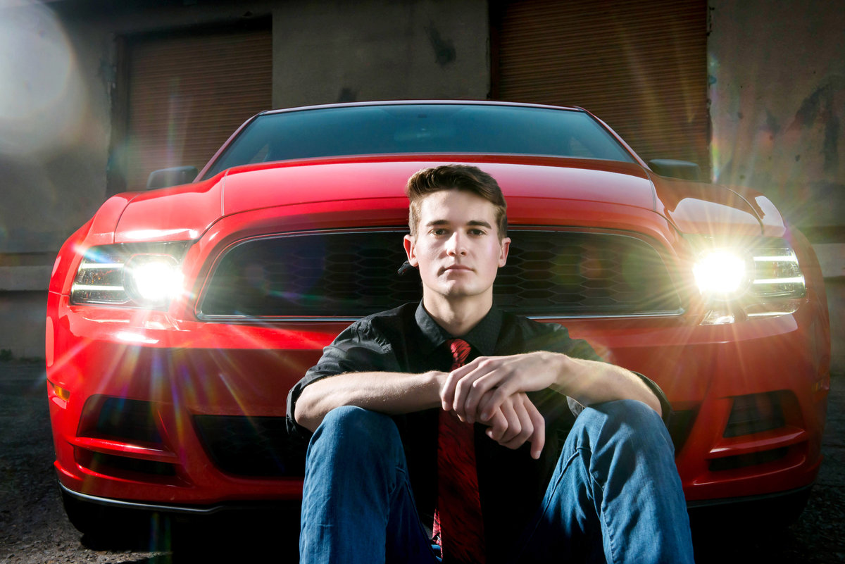 high school senior with red mustang