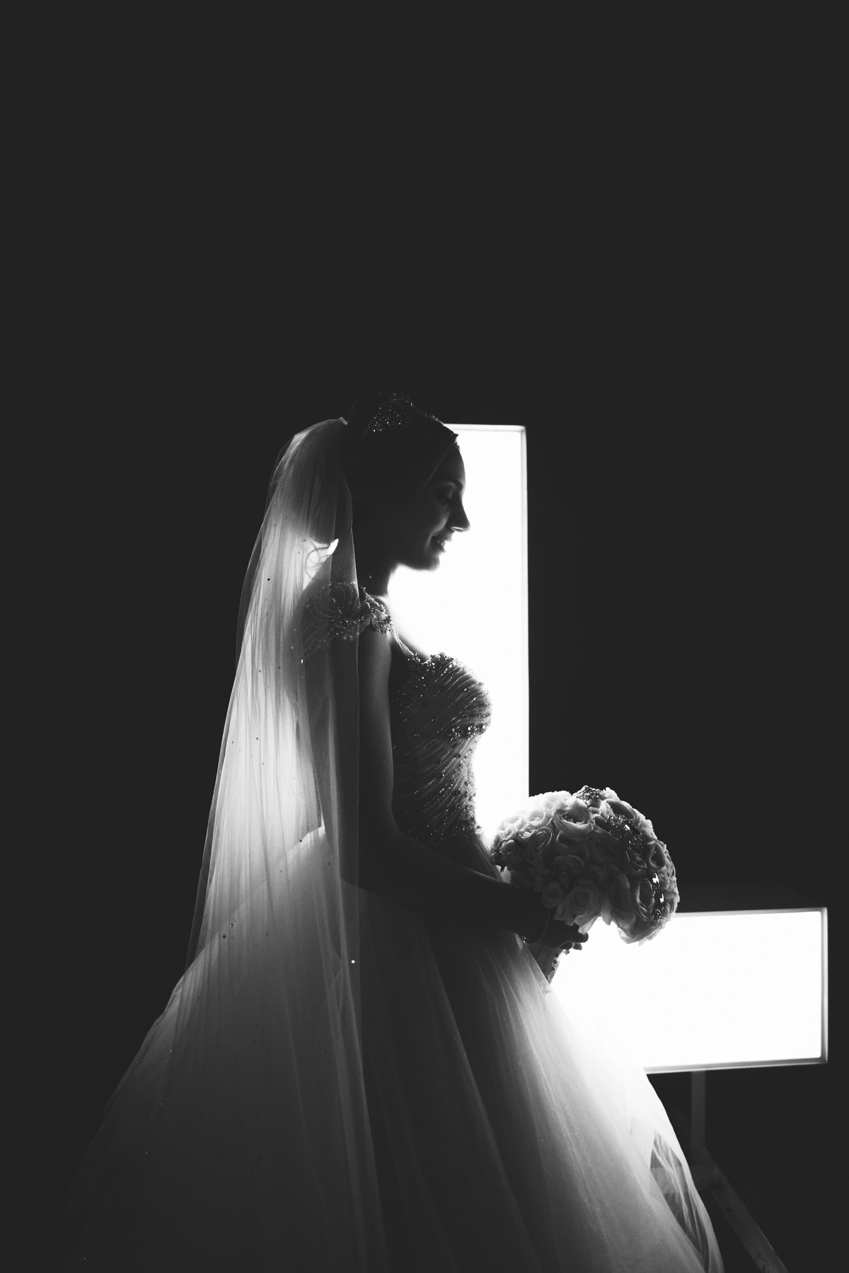 Bride silhouetter in front of the Love sign at Harbor Club