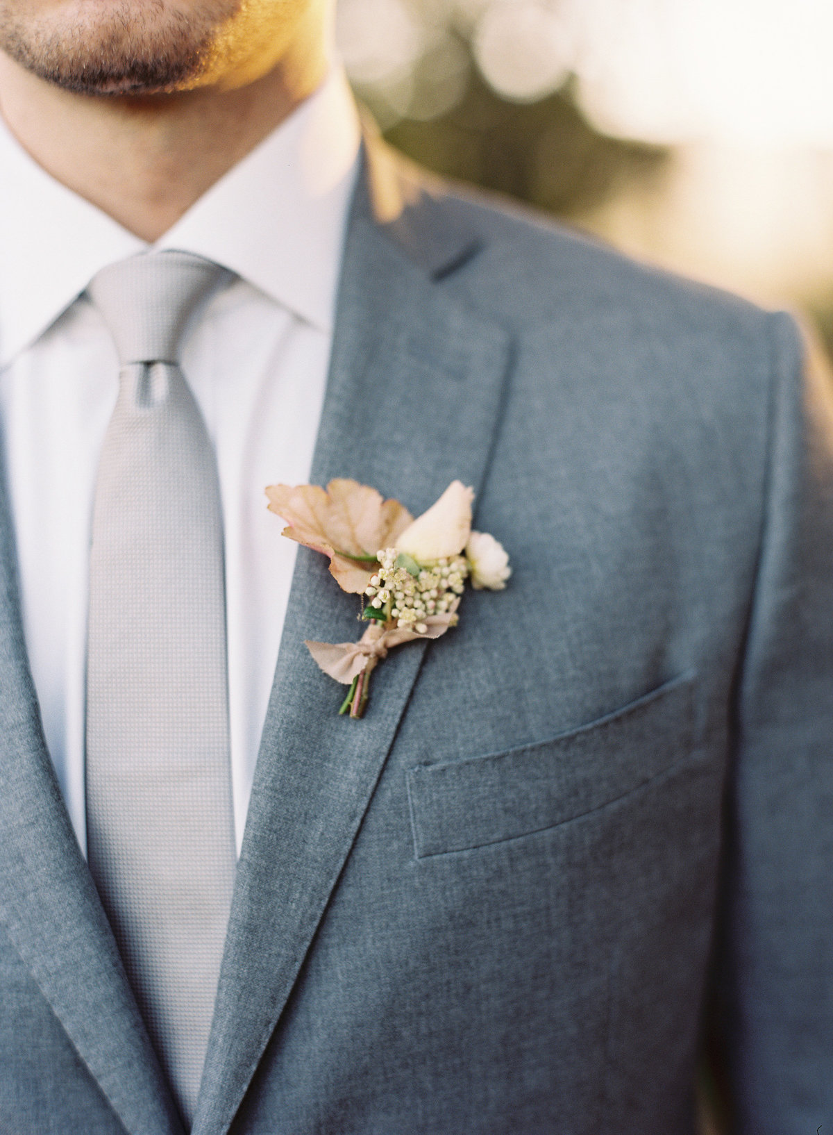 Boutonniere for wedding by Jenny Schneider Events in Napa Valley, California. Photo by Eric Kelley Photography.