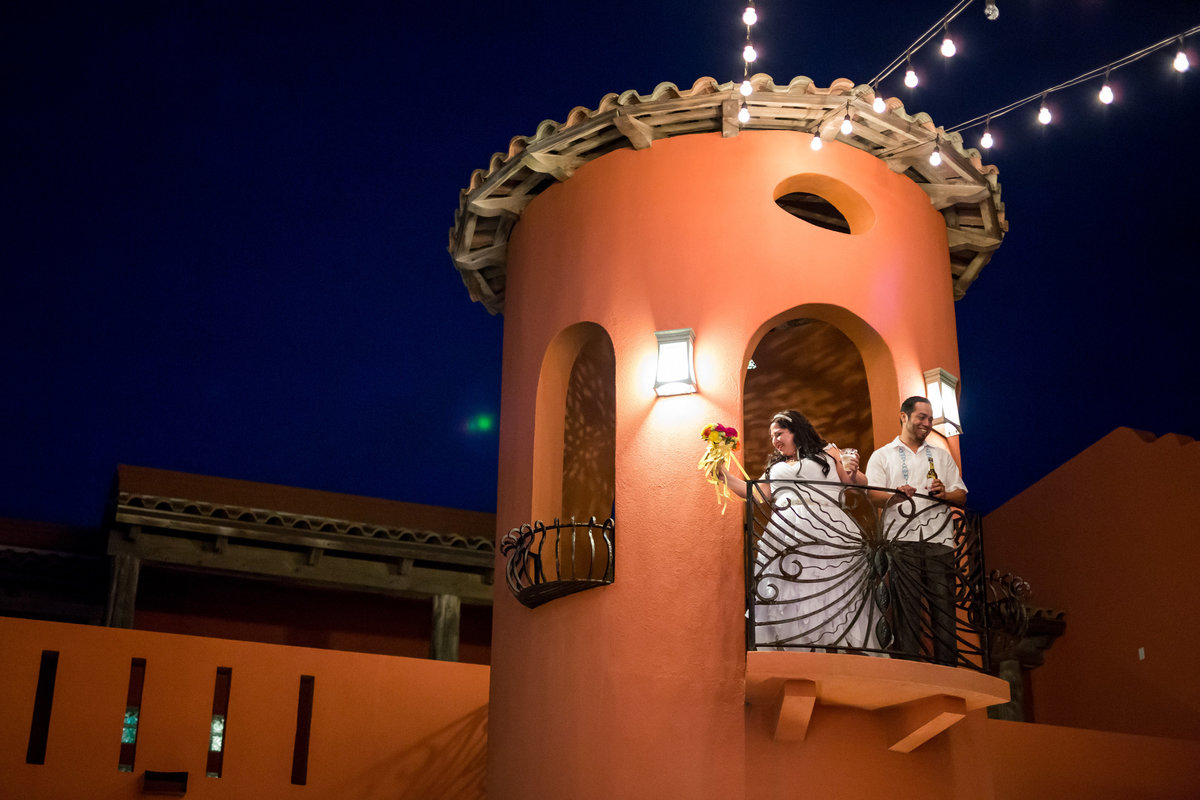 bride and groom toast off balcony of turret at Casa Mariposa reception in South Padre Island Texas