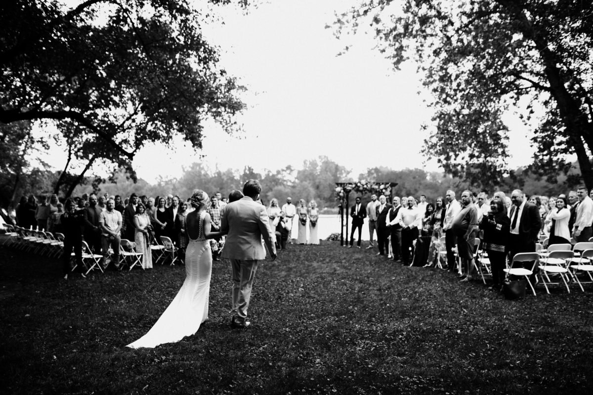 One of the top wedding photos of 2019. Taken by Adore Wedding Photography- Toledo Ohio Wedding Photographers. This photo is of father walking his daughter down the asile at her wedding by the river