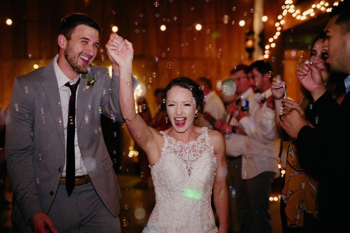 happy-bride-groom-bubble-exit-bride-groom-Arkansas-wedding