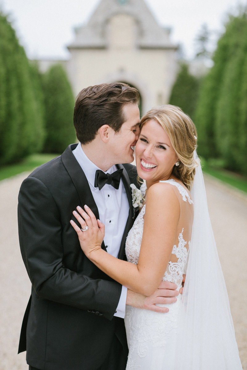 oheka castle wedding love classic happy candid bright clean bride and groom black tie event bow tie giggle sweet moment