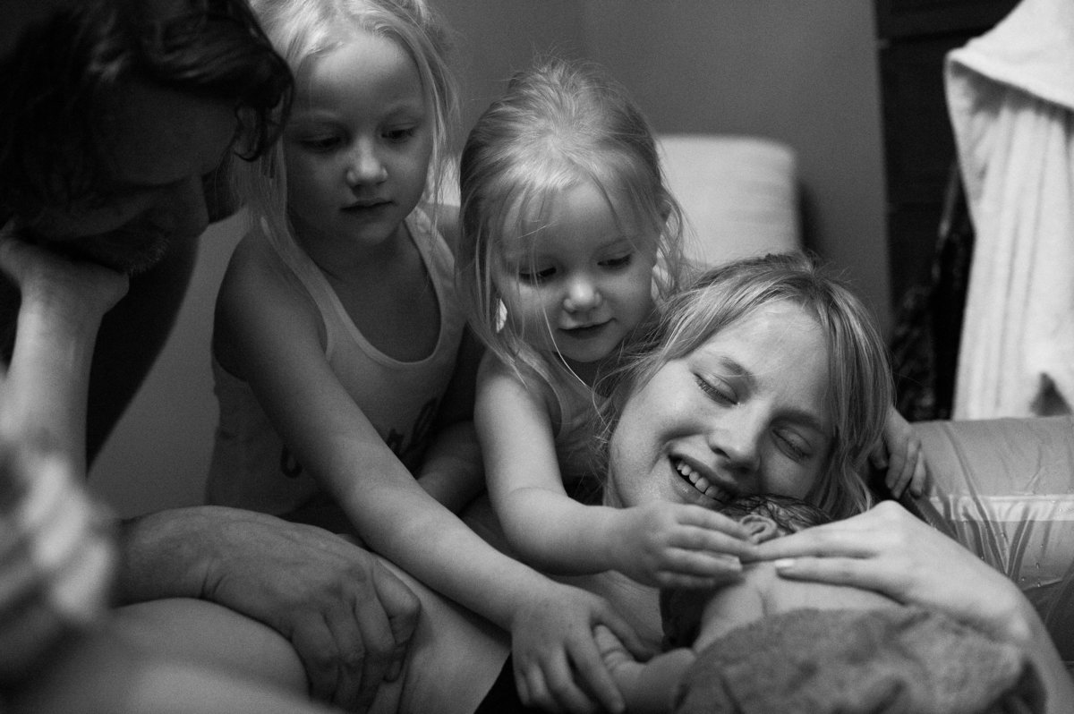 sisters meeting their baby brother after home birth