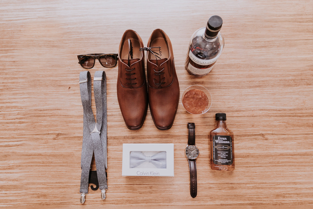 Lake Tahoe elopement photographs groom's accessories on table