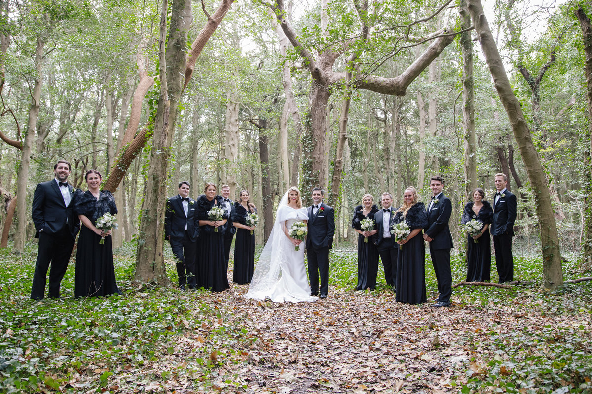 bridal party in woods in spring lake wedding
