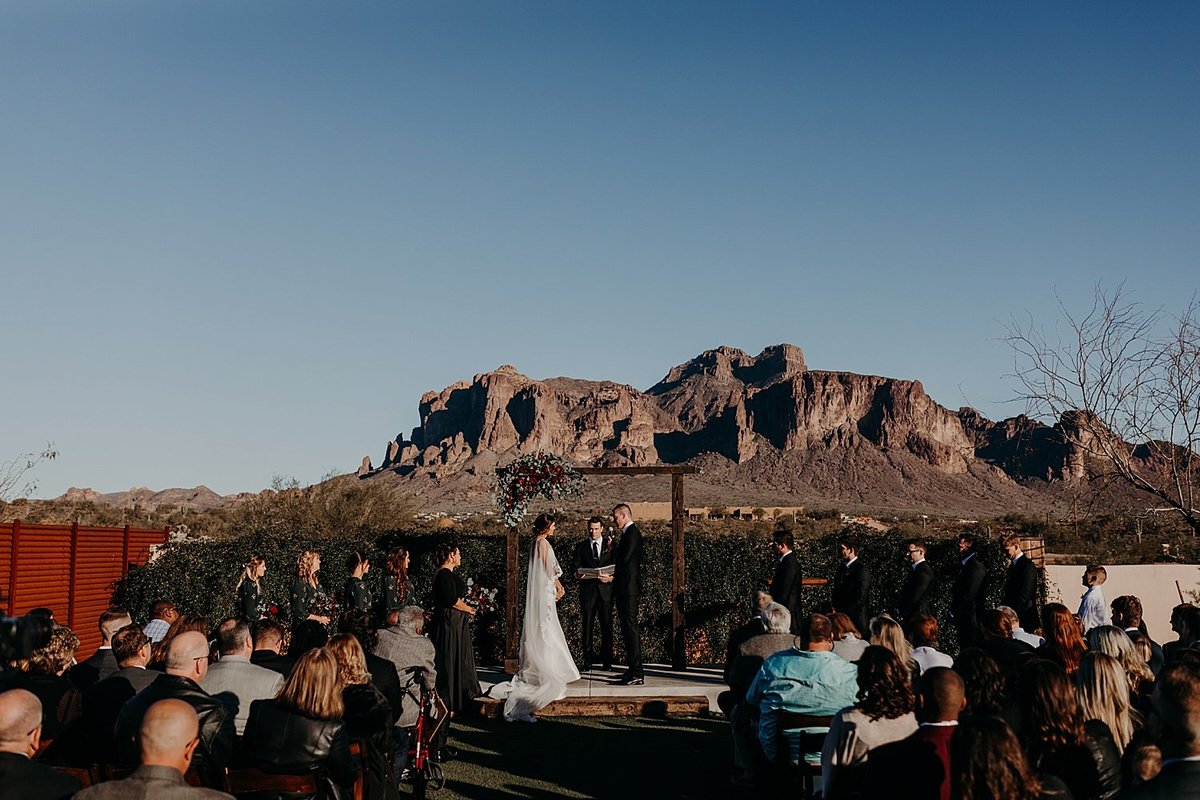 Sunny ceremony at the Paseo with the superstition mountains in the background