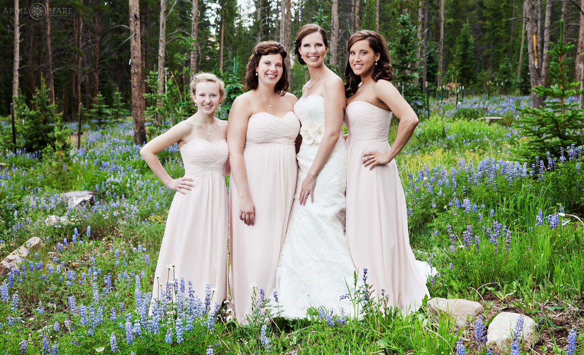 Bridesmaid photography in the woods with wildflowers in Breckenridge Colorado